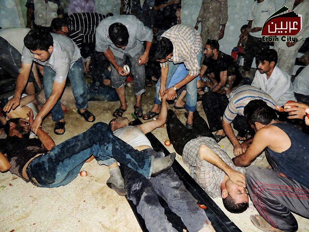 . This citizen journalism image provided by the Local Committee of Arbeen which has been authenticated based on its contents and other AP reporting, shows Syrian citizens receiving treatment after an alleged poisonous gas attack fired by regime forces, according to activists in Arbeen town, Damascus, Syria, Wednesday, Aug. 21, 2013.  (AP Photo/Local Committee of Arbeen)