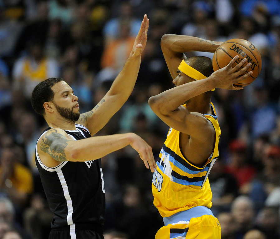 . DENVER, CO. - MARCH 29: Deron Williams (8) of the Brooklyn Nets got up in the face of Corey Brewer (13) of the Denver Nuggets in the second half. The Denver Nuggets defeated the Brooklyn Nets 109-87 Friday night, March 29, 2013 at the Pepsi Center in Denver.  (Photo By Karl Gehring/The Denver Post)