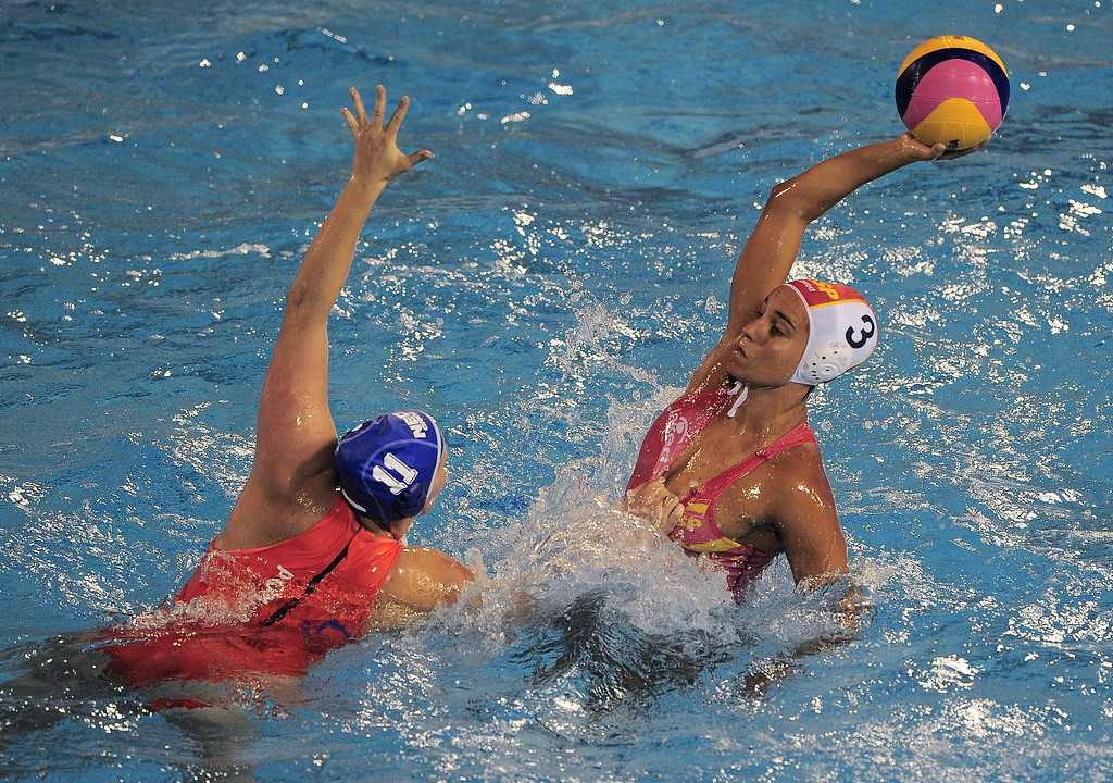 . Spain\'s Anna Aspar (R) vies with Netherlands\' Leike Klaassen (L) during their preliminary round match of the women\'s water polo competition at the FINA World Championships in Bernat Picornell pools in Barcelona on July 21, 2013.    JOSEP LAGO/AFP/Getty Images