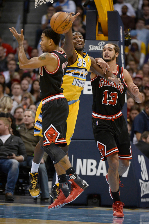 . Denver Nuggets power forward Kenneth Faried (35) slaps the ball away from Chicago Bulls point guard Derrick Rose (1) and Chicago Bulls center Joakim Noah (13) during the third quarter  November 21, 2013 at Pepsi Center. (Photo by John Leyba/The Denver Post)