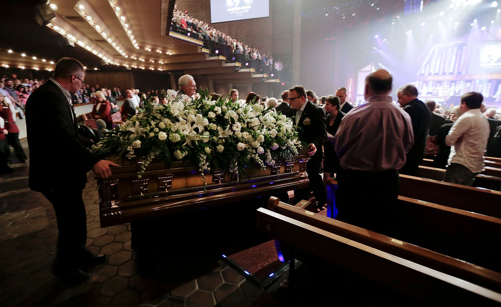 . The casket of country music star George Jones is taken out of the Grand Ole Opry House following his funeral on Thursday, May 2, 2013, in Nashville, Tenn. Jones, one of country music\'s biggest stars who had No. 1 hits in four separate decades, died April 26.  (AP Photo/Mark Humphrey, Pool)