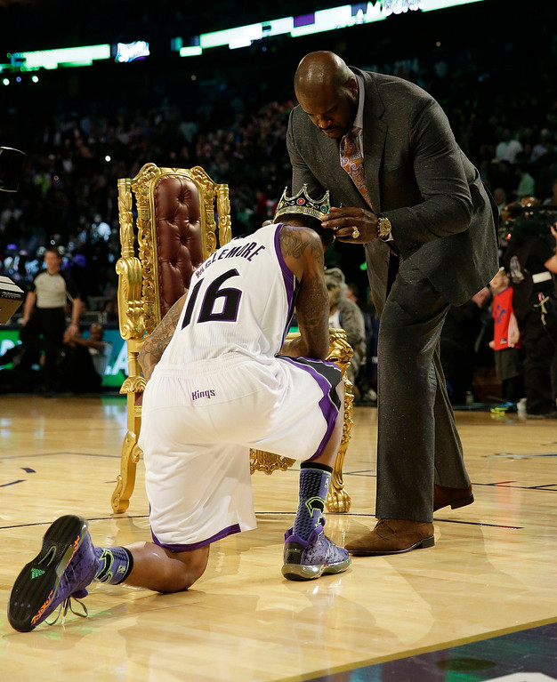 . Ben McLemore of the Sacramento Kings receives a crown after dunking the ball over former NBA player Shaquille O\'Neal during the skills competition at the NBA All Star basketball game, Saturday, Feb. 15, 2014, in New Orleans. (AP Photo/Gerald Herbert)