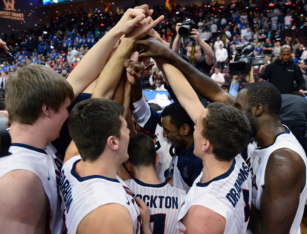 . Members of the Gonzaga Bulldogs celebrate on the court after winning the championship game of the West Coast Conference Basketball tournament 75-64 over the Brigham Young Cougars at the Orleans Arena on March 11, 2014 in Las Vegas, Nevada.  (Photo by Ethan Miller/Getty Images)