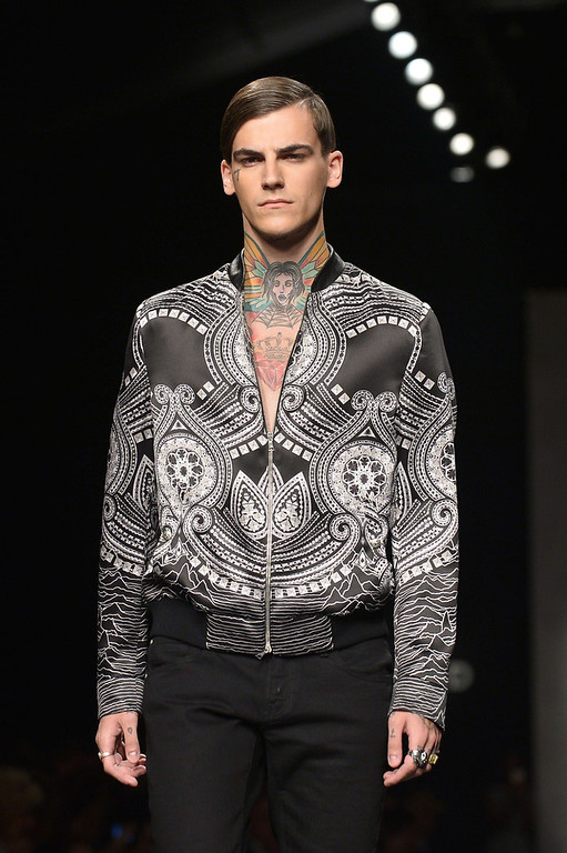 . A model presents a creation as part of John Richmond Menswear Spring-Summer 2015 collection on June 22, 2014 during the Men\'s fashion week in Milan. (TIZIANA FABI/AFP/Getty Images)