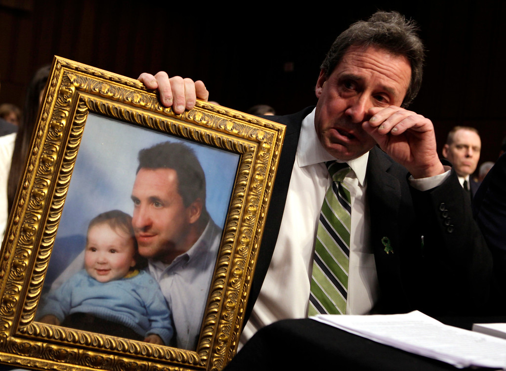 . Neil Heslin, father of 6-year-old Newtown victim Jesse Lewis, cries during the Senate Judiciary Committee hearing on the Assault Weapons Ban of 2013 on Capitol Hill in Washington February 27, 2013. REUTERS/Yuri Gripas