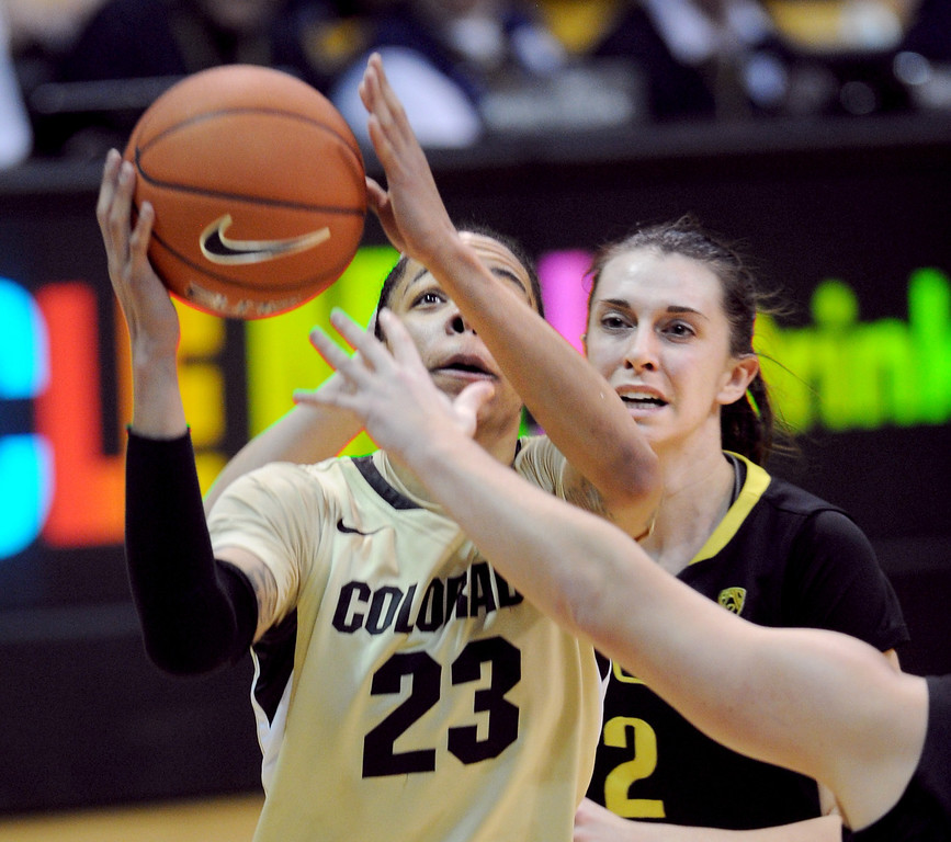. Chucky Jeffery of CU drives past Danielle Love of Oregon. Cliff Grassmick / February 10, 2013