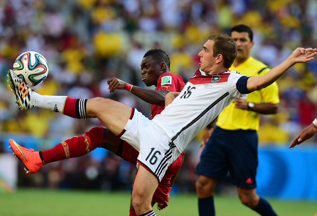 . Ghana\'s midfielder Christian Atsu Twasam (L) vies with Germany\'s defender and captain Philipp Lahm during a Group G football match between Germany and Ghana at the Castelao Stadium in Fortaleza during the 2014 FIFA World Cup on June 21, 2014.  JAVIER SORIANO/AFP/Getty Images