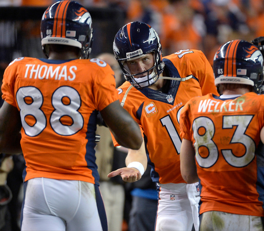. Denver Broncos quarterback Peyton Manning (18) greets  wide receiver Demaryius Thomas (88) after Thomas caught a touchdown pass during the fourth quarter. Denver Broncos Baltimore Ravens September 5, 2013 at Sports Authority at Mile High. (Photo by Joe Amon/The Denver Post)