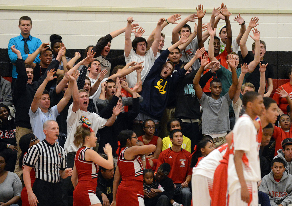 . East High School students cheer the team during the game against Cherry Creek\'s at East High School on Friday, Nov. 30, 2012. Hyoung Chang, The Denver Post