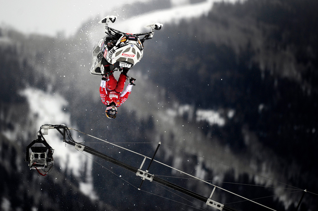 . ASPEN, CO - January 26: Levi LaVallee completes a flip during the Snowmobile Speed & Style event at Winter X Games Aspen 2013 at Buttermilk Mountain on Jan. 26, 2013, in Aspen, Colorado. LaVallee won the gold medal in the event. (Photo by Daniel Petty/The Denver Post)