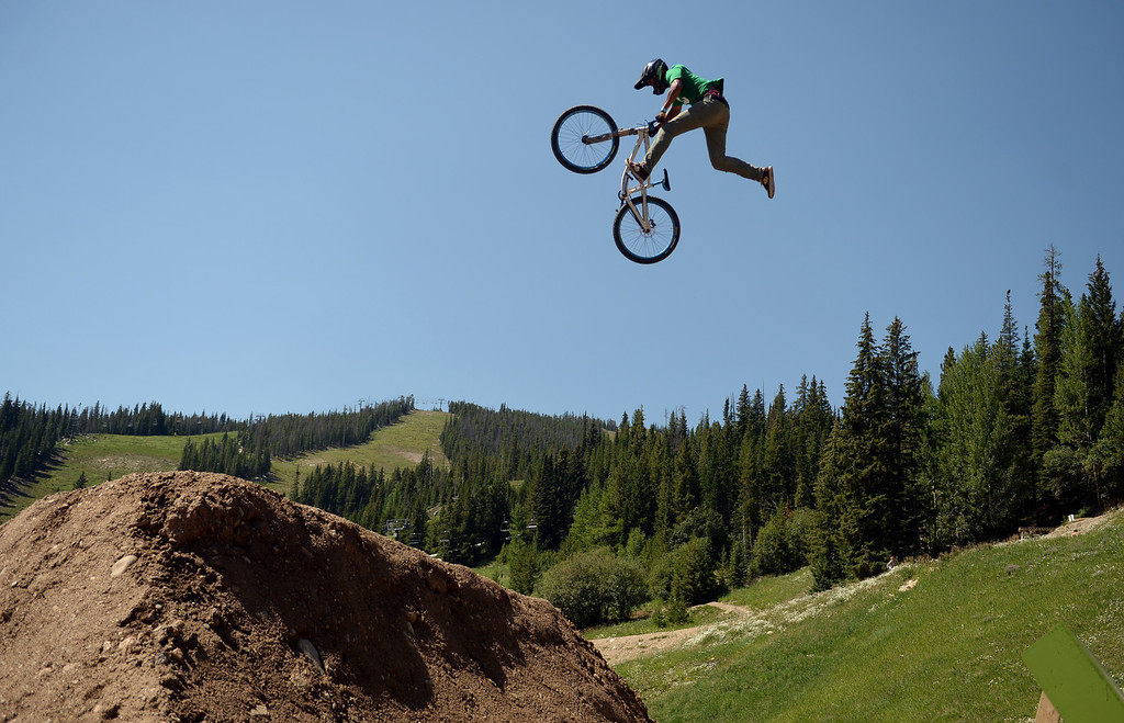 . WINTER PARK, CO. - July 26: Ray George catches air during FMB Gold Slopestyle Open Training of First international Enduro World Cup Championship ever in U.S. at Winter Park, Colorado. July 26, 2013. (Photo By Hyoung Chang/The Denver Post)