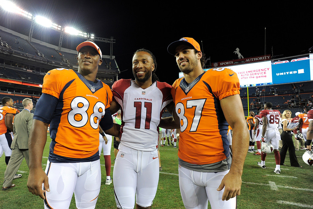 . Denver Broncos wide receiver Demaryius Thomas (88) and wide receiver Eric Decker (87) pose with Arizona Cardinals wide receiver Larry Fitzgerald (11) for a photo following the fourth quarter on August 29, 2013 at Sports Authority Field at Mile High. The Denver Broncos hosted the Arizona Cardinals in the final game of the preseason. (Photo by John Leyba/The Denver Post)