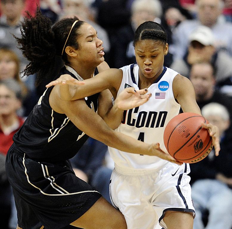 . Connecticut\'s Moriah Jefferson, right, steals the ball from Idaho\'s Ali Forde, left, in the second half of a first-round game in the women\'s NCAA college basketball tournament in Storrs, Conn., Saturday, March 23, 2013. Connecticut won 105-37. (AP Photo/Jessica Hill)