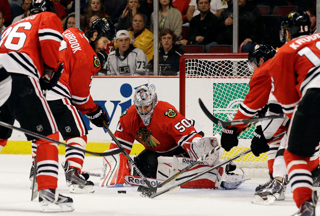 . Chicago Blackhawks goalie Corey Crawford (50) blocks a shot by Los Angeles Kings left wing Dwight King during the first period in Game 5 of the Western Conference finals in the NHL hockey Stanley Cup playoffs Wednesday, May 28, 2014, in Chicago. (AP Photo/Nam Y. Huh)