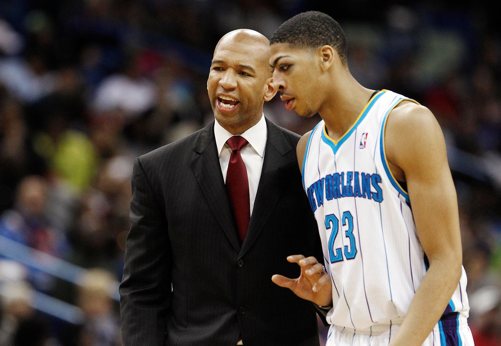 . New Orleans Hornets head coach Monty Williams talks with forward Anthony Davis (23) in the second half of an NBA basketball game in New Orleans, Monday, March 25, 2013. The Hornets won 110-86. (AP Photo/Bill Haber)