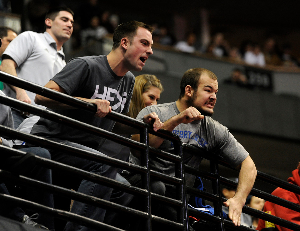 . DENVER, CO. - FEBRUARY 22ND:  Josh Hill, left, and friend, Tanner Harms, right, cheer on Harms\' brother, Mason Harms, Cherry Creek High School, during Mason\'s quarterfinal match against Harley Korte, Cherokee Trail at the Colorado State Wrestling Championships at the Pepsi Center in Denver, Colorado, February 22nd, 2013. (Photo By Andy Cross / The Denver Post)