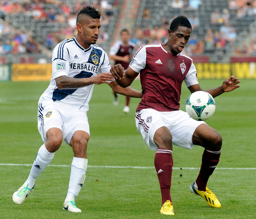 . COMMERCE CITY, CO. - JULY 27:  Galaxy defender Sean Franklin, left, tried to take the ball from Rapids midfielder Deshorn Brown, right, in the first half. The Colorado Rapids hosted the Los Angeles Galaxy Saturday, July 27, 2013.  Photo By Karl Gehring/The Denver Post