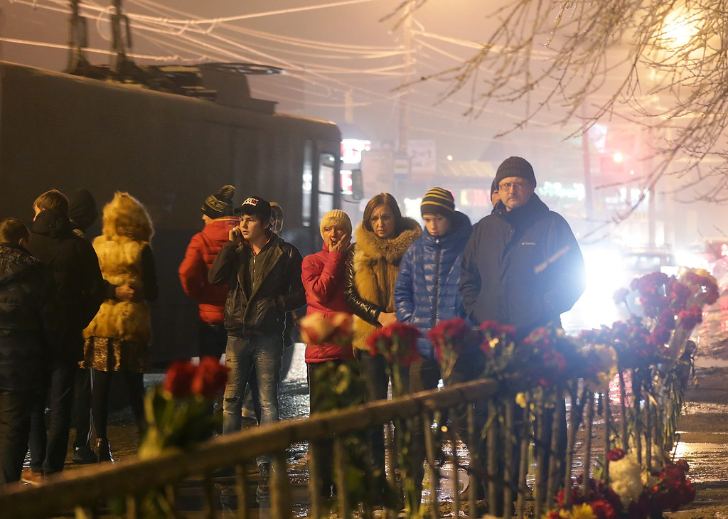 . Russian people grieve at the site of the second terrorist explosion happened on a trolleybus, at a street in Volgograd, Russia, late Monday, Dec. 30, 2013. According to media reports, at least 31 people were killed and many were injured in two suicide bombing attack in the city during the last two days.  EPA/MAXIM SHIPENKOV