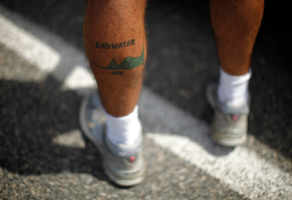 . A man shows a Badwater tattoo during the Badwater Ultramarathon in Death Valley National Park, California July 15, 2013. The 135-mile (217 km) race, which bills itself as the world\'s toughest foot race, goes from Death Valley to Mt. Whitney, California in temperatures which can reach 130 degrees Fahrenheit (55 Celsius).  REUTERS/Lucy Nicholson