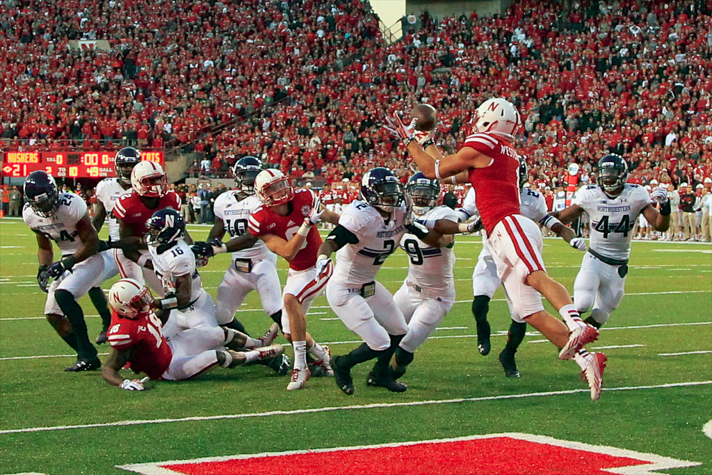 . Nebraska wide receiver Jordan Westerkamp (1) catches the game winning touchdown over Northwestern center back Dwight White (2) , safety Jimmy Hall (9) and linebacker Chi Chi Ariguzo (44) with seconds to go in the second half of an NCAA college football game against Northwestern in Lincoln, Neb., Saturday, Nov. 2, 2013. Nebraska won 27-24. (AP Photo/Nati Harnik)