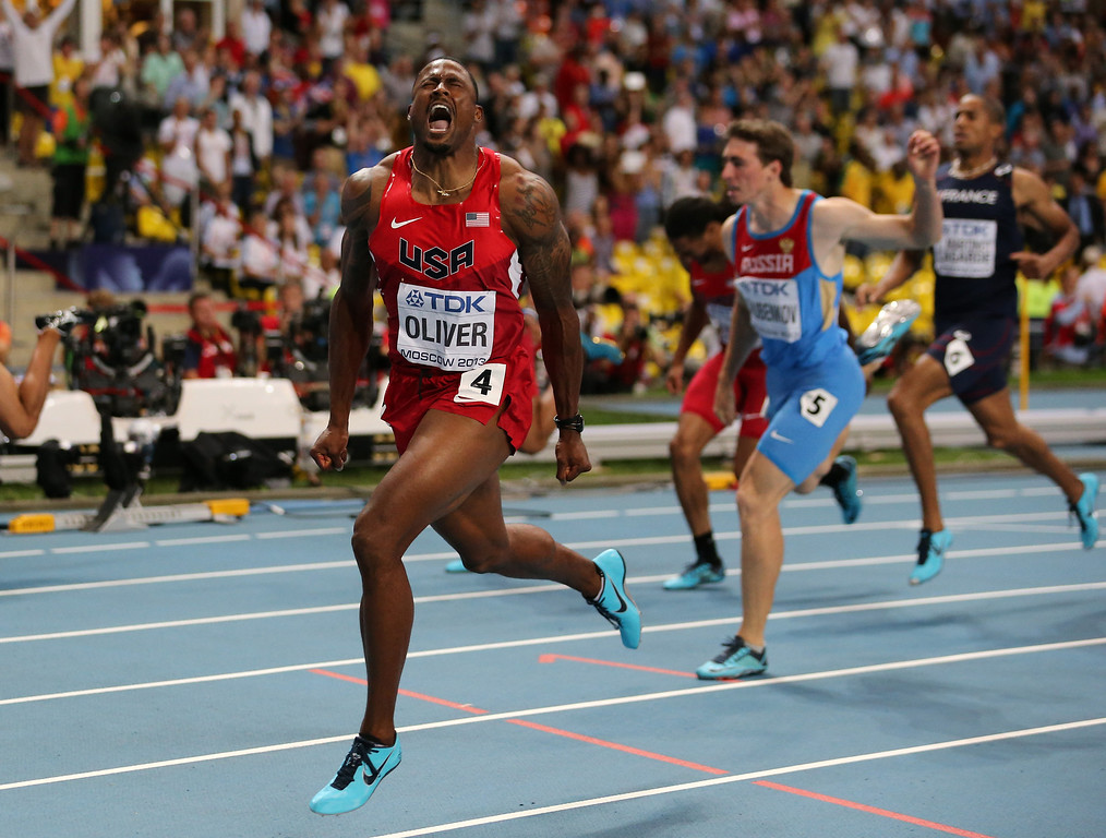 . David Oliver of the United States crosses the line to win gold in the Men\'s 110 meters hurdles final during Day Three of the 14th IAAF World Athletics Championships Moscow 2013 at Luzhniki Stadium on August 12, 2013 in Moscow, Russia.  (Photo by Ian Walton/Getty Images)