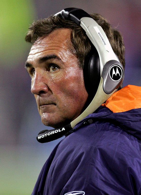 . Denver Broncos coach Mike Shanahan looks on from the sidelines during NFL football action against the Buffalo Bills in this Dec. 17, 2005 photo, in Orchard Park, N.Y. Shanahan takes no offense to the notion that Bill Belichick has surpassed him as the NFL\'s best coach. In fact, Shanahan says, he saw it coming. The Denver coach, one of the few who has a winning record against Belichick since he started with New England, has a chance to climb back on top, when they meet in the playoffs. (AP Photo/David Duprey)