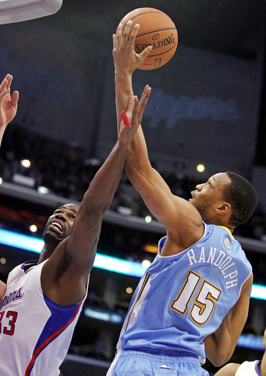 . Denver Nuggets forward Anthony Randolph (15) grabs a rebound over Los Angeles Clippers forward Antawn Jamison during the first half of an NBA basketball game in Los Angeles on Saturday, Dec. 21, 2013. (AP Photo/Alex Gallardo)