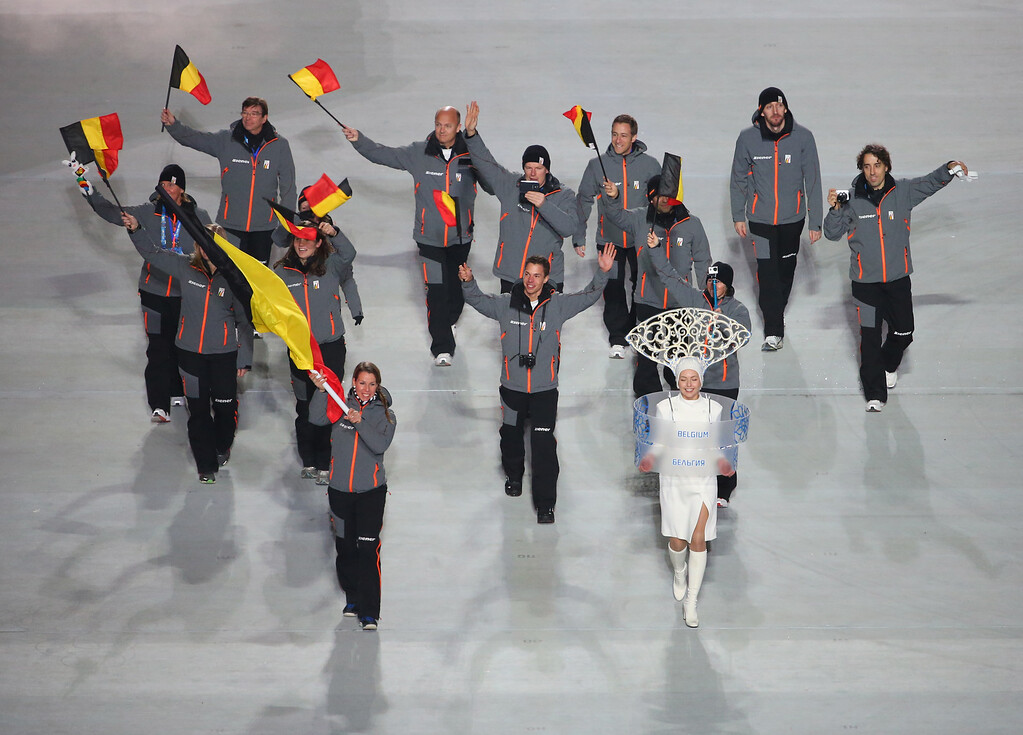 . Bobsledder Hanna Emilie Marien of the Belgium Olympic team carries her country\'s flag during the Opening Ceremony of the Sochi 2014 Winter Olympics at Fisht Olympic Stadium on February 7, 2014 in Sochi, Russia.  (Photo by Quinn Rooney/Getty Images)