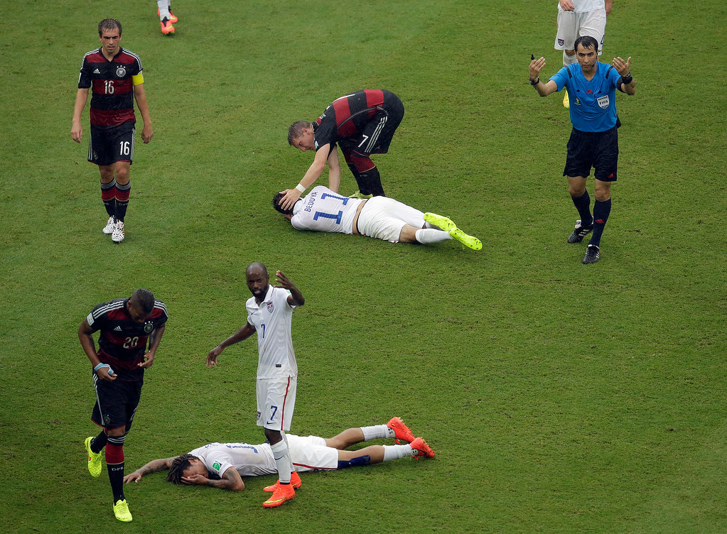 . United States\' Jermaine Jones, foreground, and United States\' Alejandro Bedoya (11) lie injured after colliding with each other during the group G World Cup soccer match between the USA and Germany at the Arena Pernambuco in Recife, Brazil, Thursday, June 26, 2014. (AP Photo/Hassan Ammar)