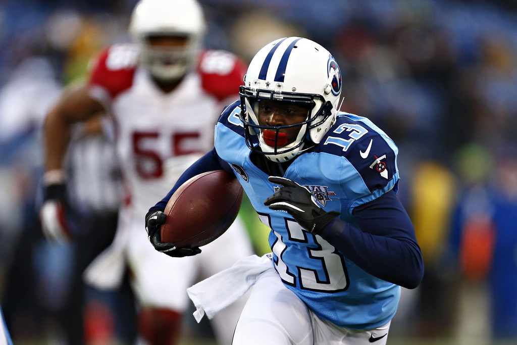 Description of . Kendall Wright #13 of the Tennessee Titans runs the ball after catching a pass against the Arizona Cardinals at LP Field on December 15, 2013 in Nashville, Tennessee.  (Photo by Wesley Hitt/Getty Images)