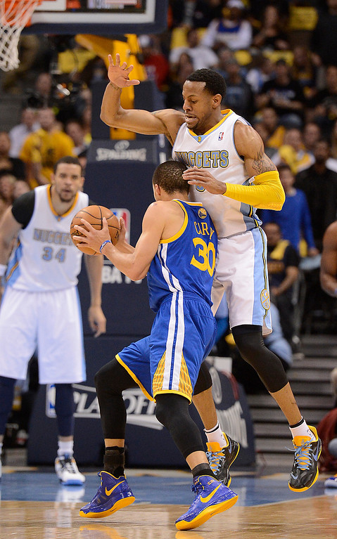 . Golden State Warriors point guard Stephen Curry (30) dribbles past Denver Nuggets shooting guard Andre Iguodala (9) in the first quarter. The Denver Nuggets took on the Golden State Warriors in Game 5 of the Western Conference First Round Series at the Pepsi Center in Denver, Colo. on April 30, 2013. (Photo by John Leyba/The Denver Post)