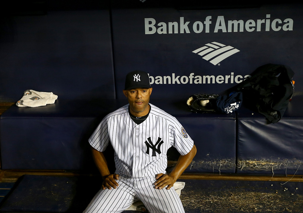 . NEW YORK, NY - SEPTEMBER 26:  Mariano Rivera #42 of the New York Yankees sits in the dugout after the game against the Tampa Bay Rays on September 26, 2013 at Yankee Stadium in the Bronx borough of New York City.This is his last game at Yankee Stadium. Rivera is retiring after this season.  (Photo by Elsa/Getty Images)