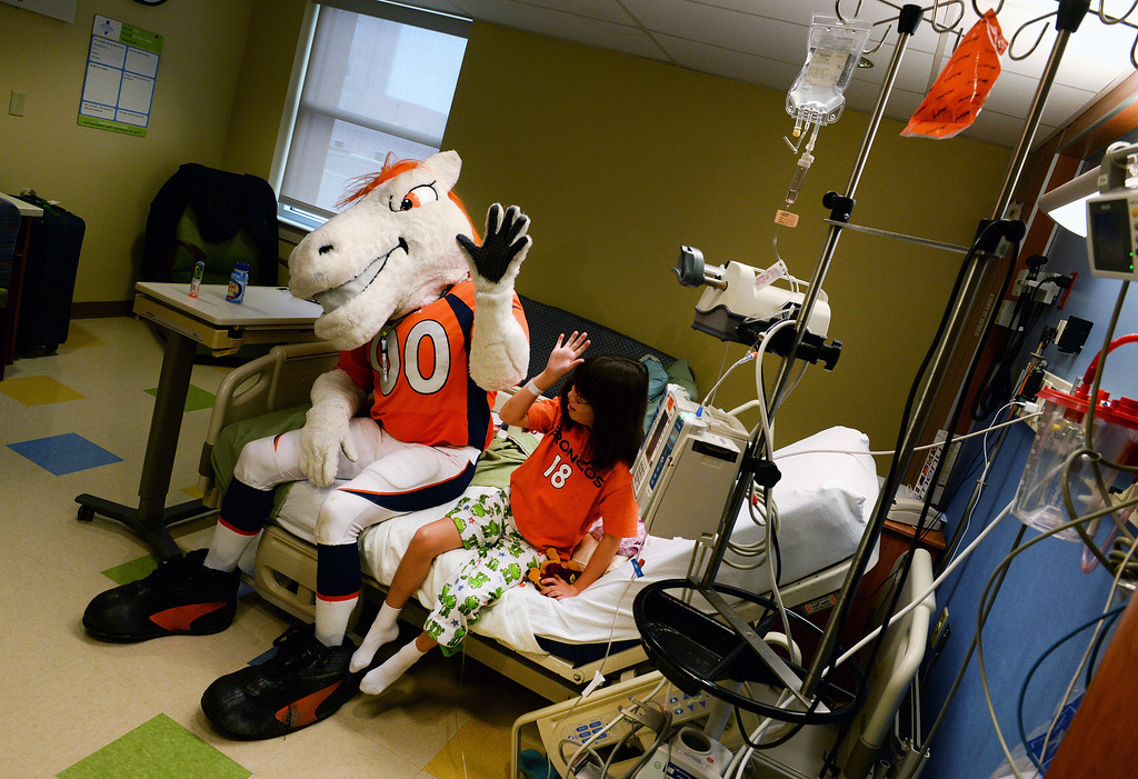 . Miles, the Broncos Mascot, visits with Haley Pasquale, 9, while in her bed in the Pediatric Intensive Care Unit at the  Rocky Mountain Hospital for Children in Denver, Co on January 14, 2014.  (Photo By Helen H. Richardson/ The Denver Post)