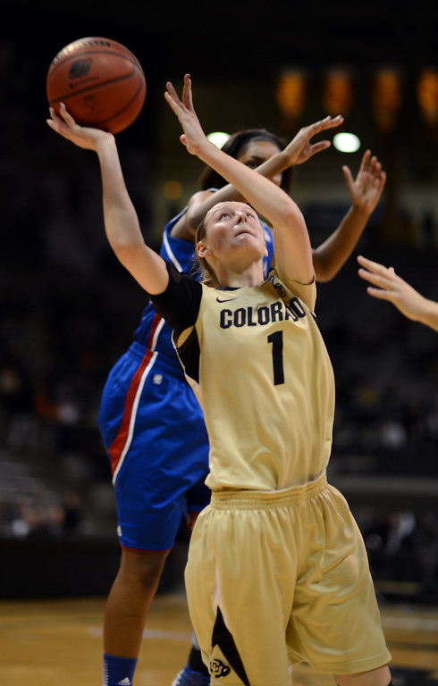 . BOULDER, CO. - MARCH 23: Lexy Kresl of Colorado Buffaloes (1) controls the ball against Kansas Jayhawks defense during the first round of the 2013 NCAA women\'s Basketball Tournament at Coors Events Center. Boulder, Colorado. March 23, 2013. (Photo By Hyoung Chang/The Denver Post)
