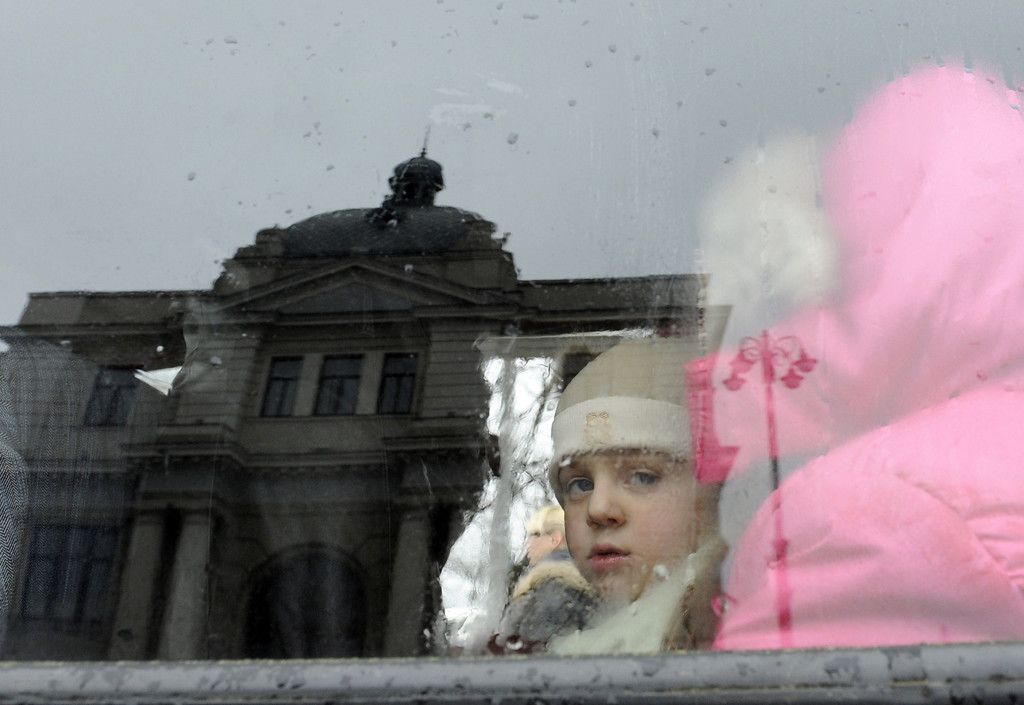 . A Crimean Tartar girl looks out from a car as she leaves the train station in Lviv with her family after disembarking from a train from Simferopol, on March 7, 2014, in the western Ukrainian city of Lviv. In the city of Lviv, across Ukraine from the crisis gripping Crimea, a group of Tatars fleeing the troubled peninsula disembarks on a train platform looking for security away from Russian forces. YURIY DYACHYSHYN/AFP/Getty Images