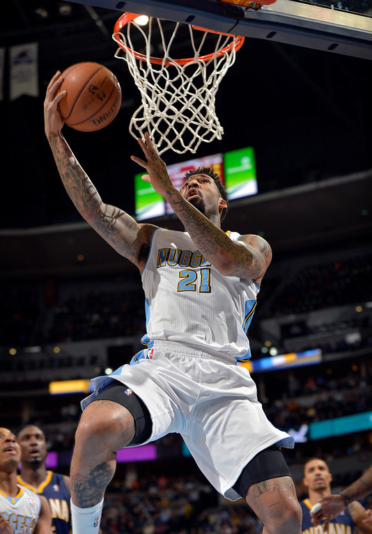 . Denver Nuggets small forward Wilson Chandler (21) goes up for a shot against the Indiana Pacers during the first quarter of an NBA basketball game Saturday, Jan. 25, 2014, in Denver. (AP Photo/Jack Dempsey)