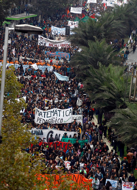 . Chilean students march through the streets demanding free education, in Santiago, Chile, Thursday, April. 11, 2013.  The marches began during the 2006-2010 Michelle Bachelet government and have troubled Chile\'s President Sebastian Pinera even more. Pinera\'s government is focusing a chunk of the 2013 budget on financing school loans at lower rates. But students say the system still fails them, with poor public schools, expensive private universities, unprepared teachers and unaffordable loans. (AP Photo/Luis Hidalgo)