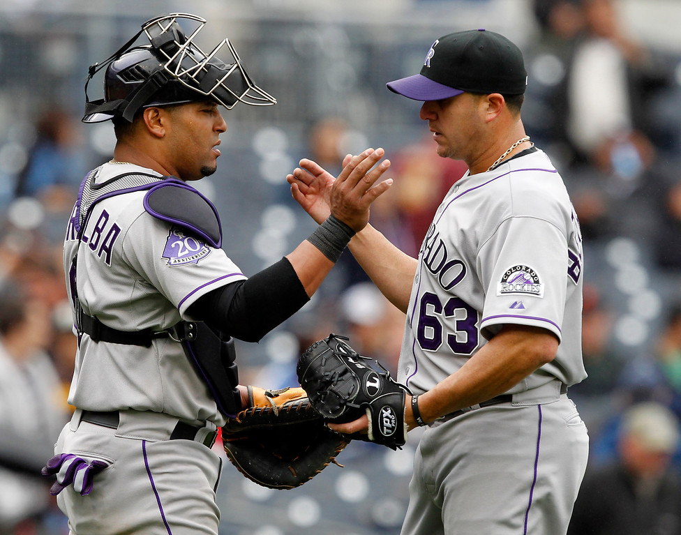 . Colorado Rockies catcher Yorvit Torrealba, left, congratulates relief pitcher Rafael Betancourt (63) after they defeated the San Diego Padres 2-1 during a baseball game on Sunday, April 14, 2013, in San Diego. (AP Photo/Alex Gallardo)