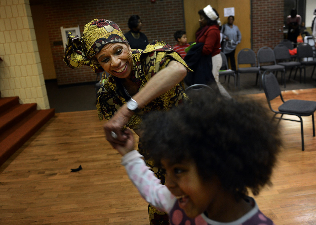 . Chaya Kidane, 6, dances with Letitia Williams during a Kwanzaa Celebration at the Zion Senior Center in Denver, CO, Saturday December, 29, 2012. The event highlighted the 150th anniversary of the Emancipation Proclamation with a theatrical performance depicting an enslaved family on Watch Night or Freedom\'s Eve, December 31, 1862. During the performance the family read the proclamation in anticipation of their coming freedom on New Years day, 1863. Craig F. Walker, The Denver Post