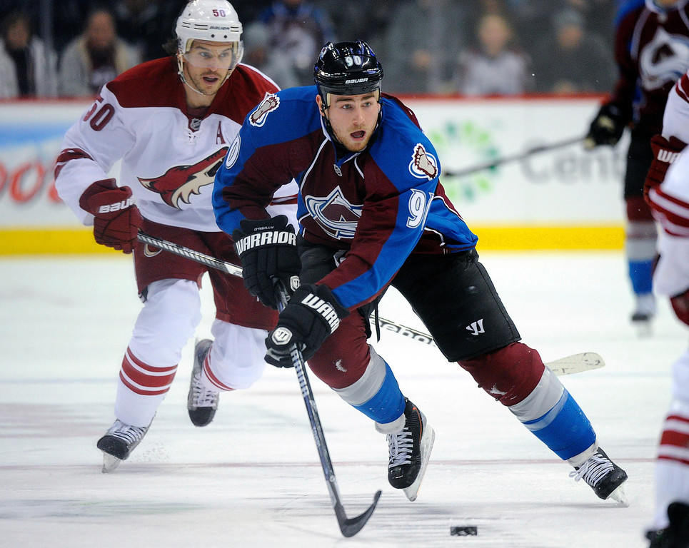 . Colorado center Ryan O\'Reilly skated with the puck in the first period as the Colorado Avalanche hosted the Phoenix Coyotes at the Pepsi Center Tuesday night, December 10, 2013.  The Coyotes beat the Avs, 3-1.  Photo By Karl Gehring/The Denver Post