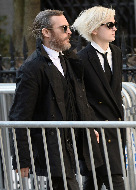 . US actor Joaquin Phoenix (L) arrives for the Funeral Mass for US Actor Phillip Seymour Hoffman at St Ignatius Church in New York, New York, USA 07 February 2014. Hoffman, 46, died 02 February from a suspected drug overdose.  EPA/ANDREW GOMBERT