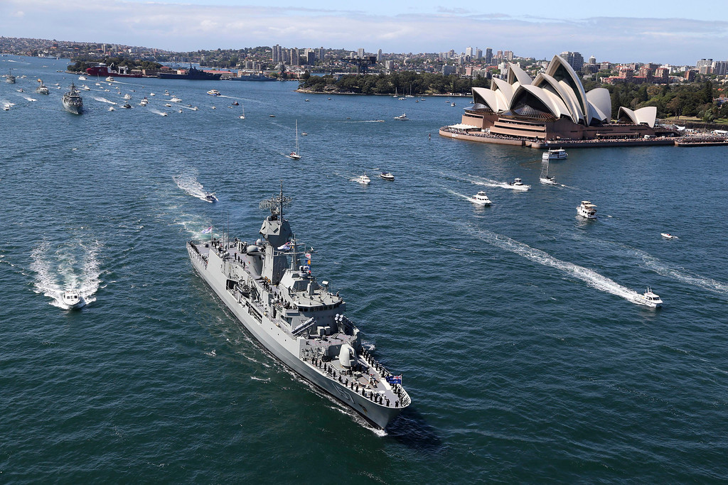 . Australian warships HMAS Perth sails past the Opera House as she arrives in Sydney, Australia, Friday, Oct. 4, 2013 during the International Fleet review. The Fleet Review is a commemorative event celebrating the centenary of the first entry of the Royal Australian Navy\'s fleet into Sydney Harbour on Oct. 4, 1913.(AP Photo/Rob Griffith)