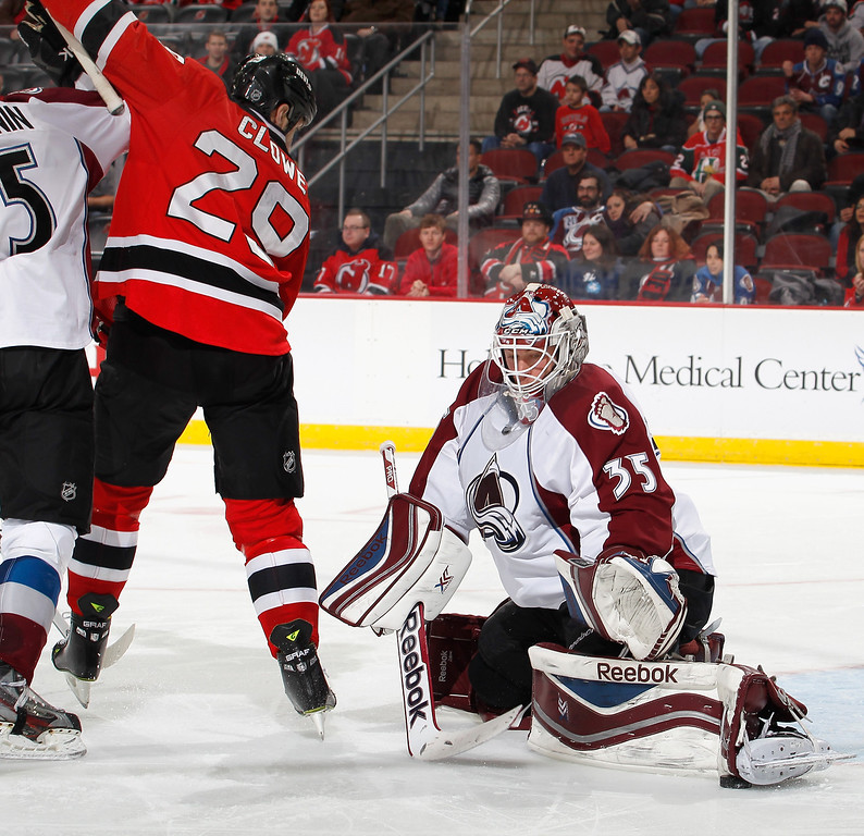 . Goalie Jean-Sebastien Giguere #35 of the Colorado Avalanche makes a save with his skate as Ryane Clowe #29 of the New Jersey Devils tries for a tip-in during the second period of an NHL hockey game at Prudential Center on February 3, 2014 in Newark, New Jersey.  (Photo by Paul Bereswill/Getty Images)
