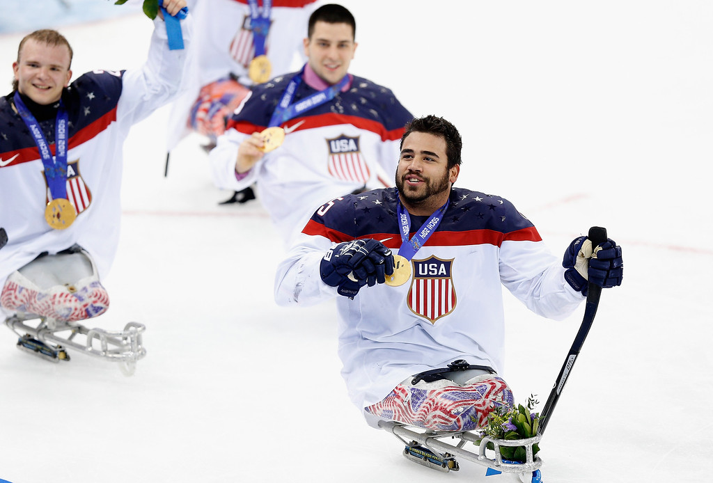 . Nikko Landeros of USA (R) celebrates after his team won the Ice Sledge Hockey Gold Medal match between Russia and USA at the Shayba Arena during day eight of the 2014 Paralympic Winter Games on March 15, 2014 in Sochi, Russia.  (Photo by Harry Engels/Getty Images)