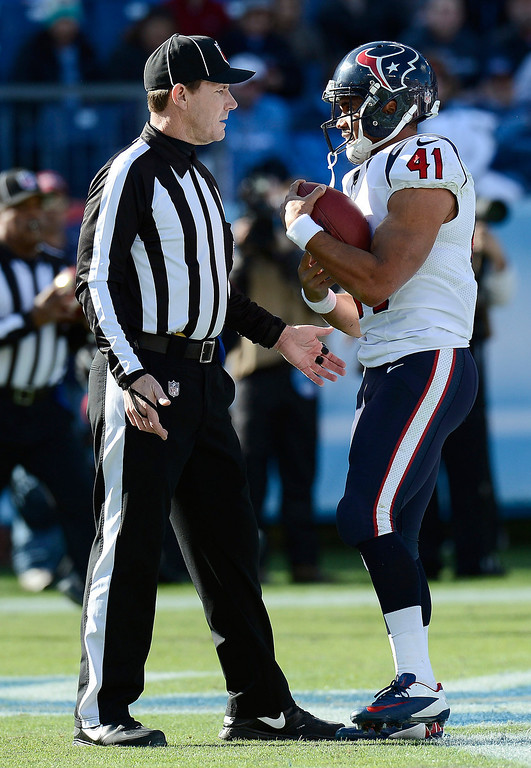 . Houston Texans running back Jonathan Grimes (41) tells back judge Lee Dyer, left, that he wants to keep the football after scoring his first career touchdown on a 3-yard run against the Tennessee Titans in the first quarter of an NFL football game Sunday, Dec. 29, 2013, in Nashville, Tenn. (AP Photo/Mark Zaleski)