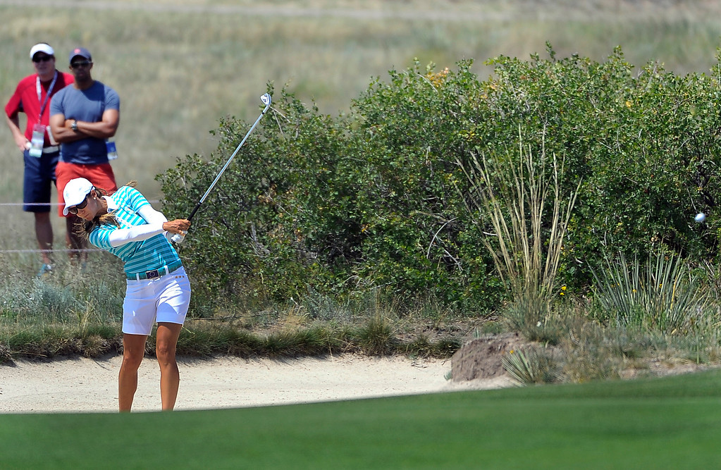 . PARKER, CO - Aug.17: Team Europe\'s Azahara Munoz hits her ball out of the bunker. The 2013 Solheim Cup takes place at the Colorado Golf Club with the USA taking on Europe in the Saturday morning Foursomes Match. (Photo By Kathryn Scott Osler/The Denver Post)