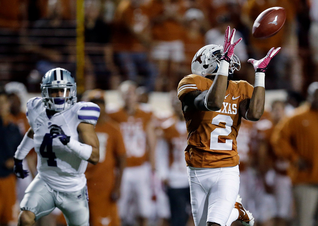 . Texas\' Kendall Sanders (2) pulls in a pass for a touchdown as Kansas State\'s Dorrian Roberts (4) defends during the first half of an NCAA college football game on Saturday,  Sept. 21, 2013, in Austin, Texas. (AP Photo/Eric Gay)