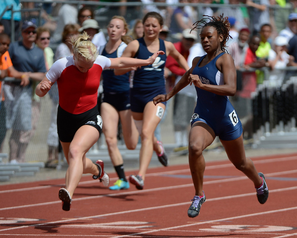 . LAKEWOOD, CO - MAY 18:  Alicia Lawrence, right, James Irwin High School, edges out Aimee Ledall, Moffet County, to win the girls 3A 100 meter dash at the Colorado State Track and Field Championships at Jeffco Stadium, Saturday morning, May 18, 2013. (Photo By Andy Cross/The Denver Post)