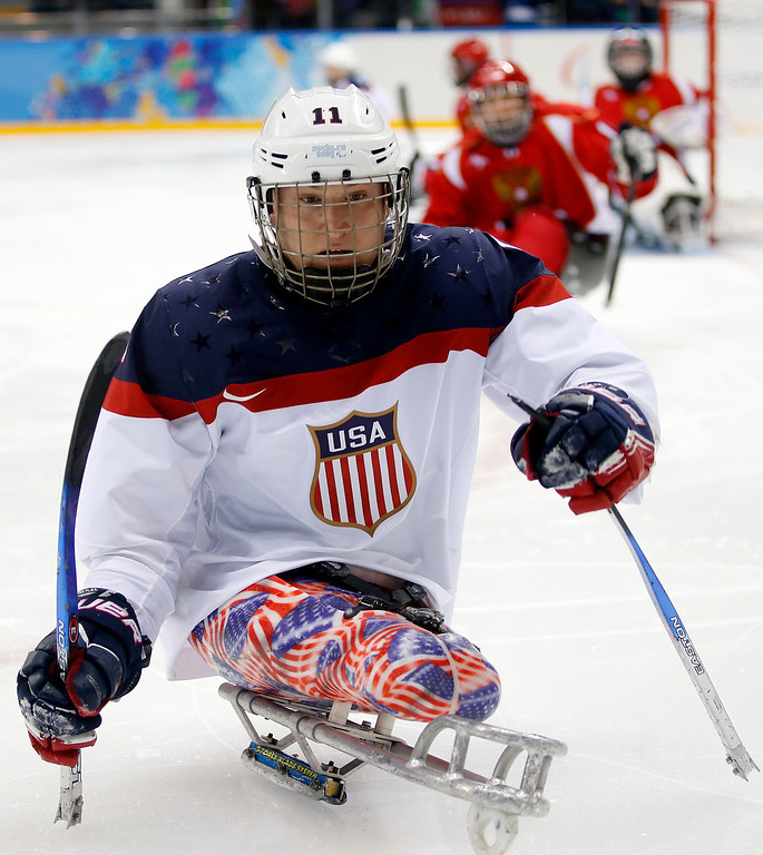 . United States\'s Tyler Carron in action during the gold medal ice sledge hockey match against Russia at the 2014 Winter Paralympics in Sochi, Russia, Saturday March 15, 2014. United States won 1-0. (AP Photo/Pavel Golovkin)