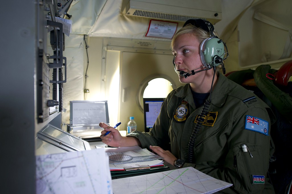 . This handout photo taken on March 19, 2014 shows Royal Australian Air Force Navigation and Communications Officer, Flying Officer Brittany Sharpe from 10 Squadron, coordinating all communications between planes from aboard an AP-3C Orion over the southern Indian Ocean.  Two objects possibly related to the search for missing Malaysia Airlines flight MH370 have been sighted in the southern Indian Ocean, Australian Prime Minister Tony Abbott said in a potential breakthrough on March 20.      AFP PHOTO / AUSTRALIAN DEFENCE/ SGT HAMISH PATERSON/AFP/Getty Images